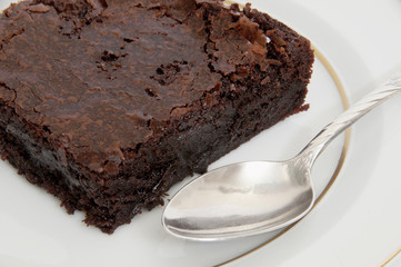 Close up of chocolate brownie and spoon