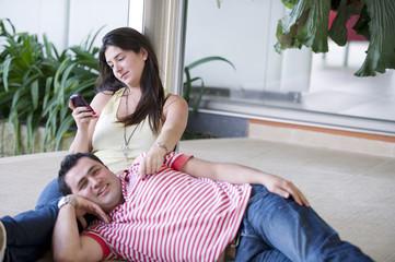 Hispanic couple relaxing on patio