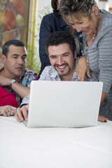 Hispanic family looking at laptop
