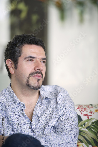 Serious Hispanic man with goatee