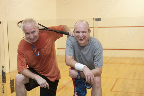 Hispanic men relaxing after racquetball