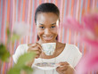 Black woman drinking tea