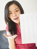 Japanese woman holding failing test