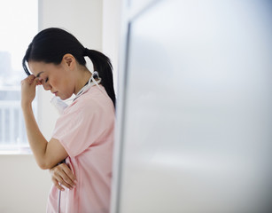 Japanese nurse with a headache