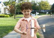 Caucasian boy playing with toy airplane