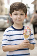 Caucasian boy eating ice cream cone