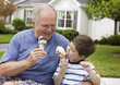 Caucasian man and grandson eating ice cream cones