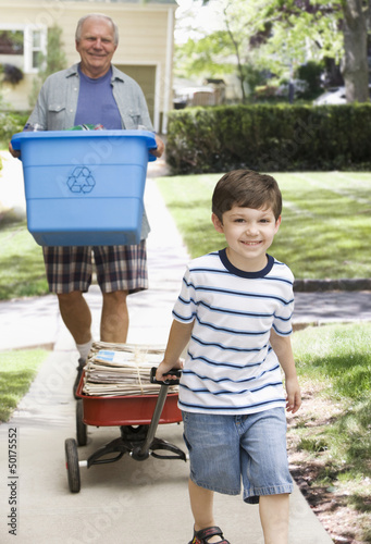 Caucasian grandfather and grandson recycling