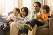 Caucasian family watching television together