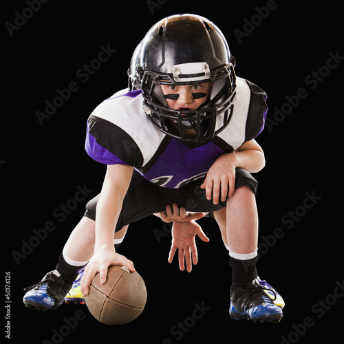 Football player hiking ball to quarterback