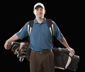 Caucasian golfer carrying golf bag