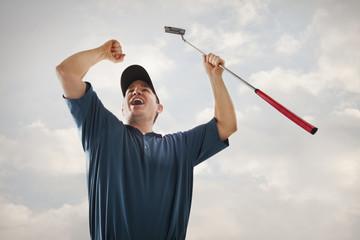 Caucasian golfer cheering