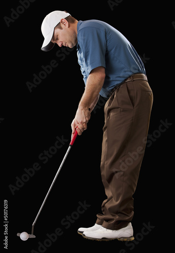 Caucasian golfer putting golf ball