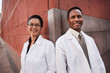 Smiling doctors standing outdoors