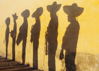Shadows of mariachi band members