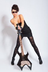 woman holding electric guitar