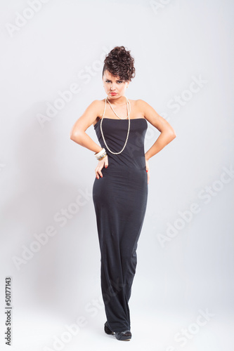 woman poses in sexy dress