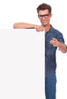 happy man with panel, pointing
