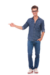 man pointing to side & hand in pocket