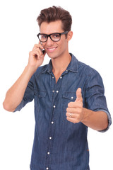 man on the phone shows thumb up
