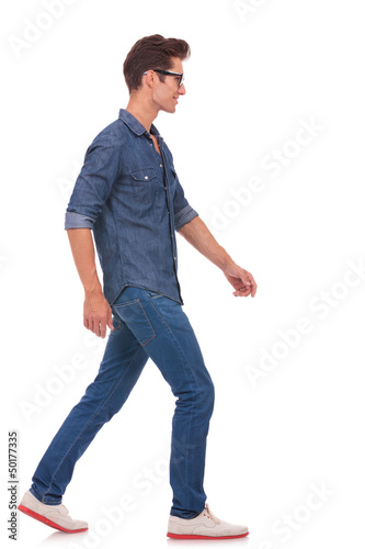 side view of man walking