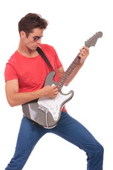 casual man plays guitar