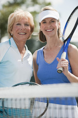 Caucasian women playing tennis