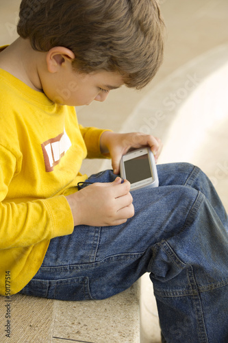 Hispanic boy playing video game