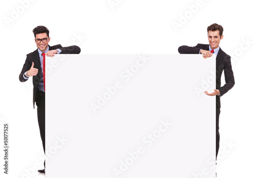 two businessmen holding a big blank sign