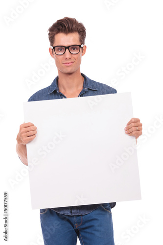 man holds small panel