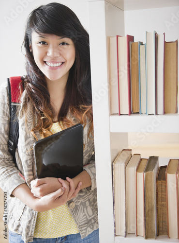 Pacific Islander woman holding digital tablet