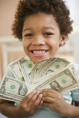 Black boy holding one dollar bills