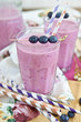 Homemade milkshake with fresh blueberries