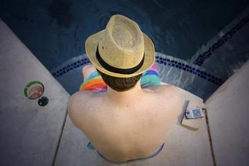 Man sitting at poolside