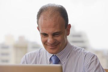 Chilean businessman using laptop at desk