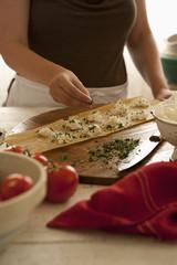 Woman preparing homemade ravioli