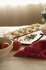 Homemade ravioli on cutting board
