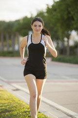 Hispanic woman running outdoors