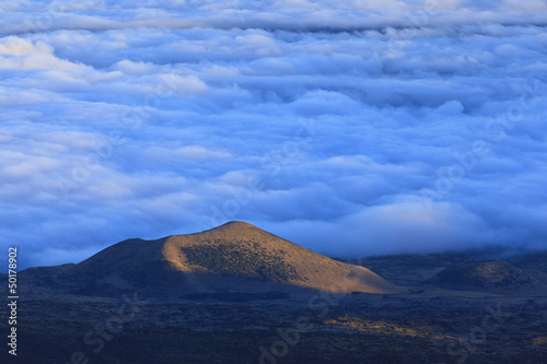 Clouds and remote hill