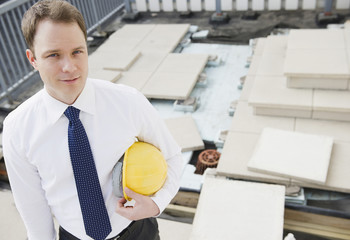 Caucasian businessman standing at construction site