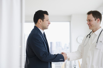 Businessman shaking hands with doctor