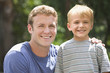 Smiling Caucasian man standing with son