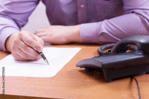 Businessman sitting at office desk