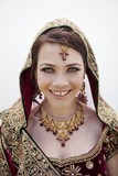 Caucasian woman in traditional Indian wedding clothing