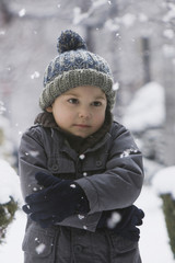 Cold Caucasian boy standing in snow