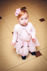 Portrait Baby dressed in pink dress