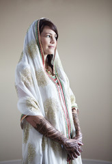 Caucasian woman with traditional Indian wedding clothing and henna tattoos