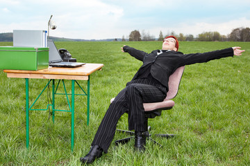 Businesswoman working in free and takes a break