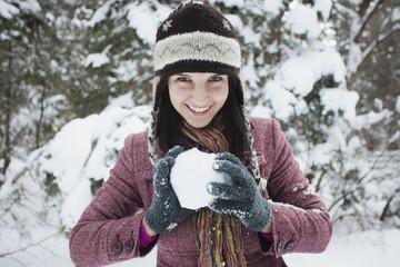Caucasian woman making snowball