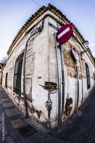 Ruined building corner with stop sign made ​​with 8mm lens